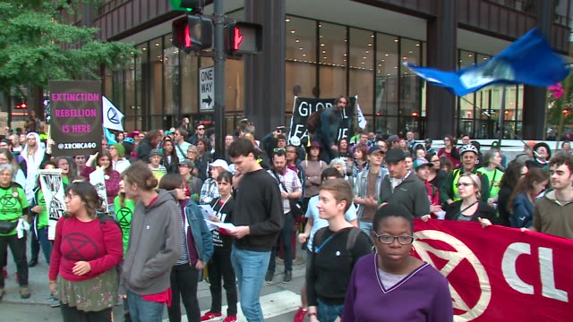 chicago, il, u.s. - climate activists gathered on street with banners and protesting in nationwide demonstration, on monday, october 7, 2019. - protestor stock videos & royalty-free footage
