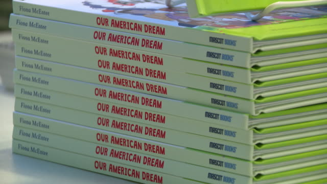 "stockvideo's en b-roll-footage met chicago, il, u.s. - close ups of ""our american dream"" book at american writers museum during book event with fiona mcentee, author of book describing... - literature"