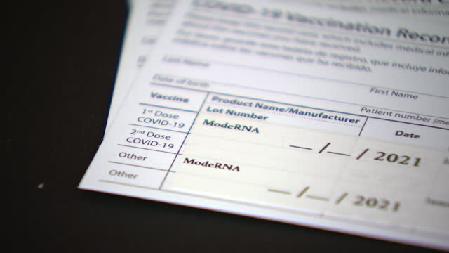 chicago, il, u.s. - close-up of cdc-issued covid-19 vaccination record cards, on tuesday, march 30, 2021. - chicago illinois stock videos & royalty-free footage