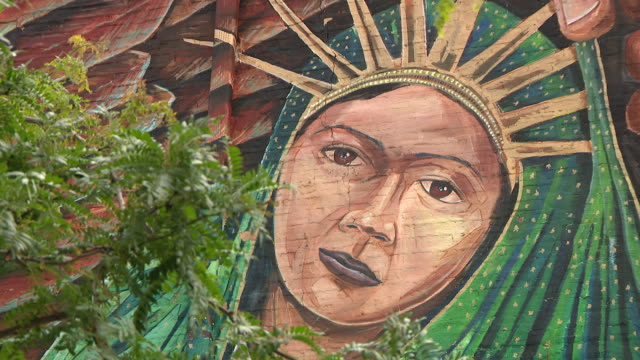 wgn chicago il us colorful mural on brick wall of closed movie theatre on tuesday june 9 2020 - female likeness stock videos & royalty-free footage