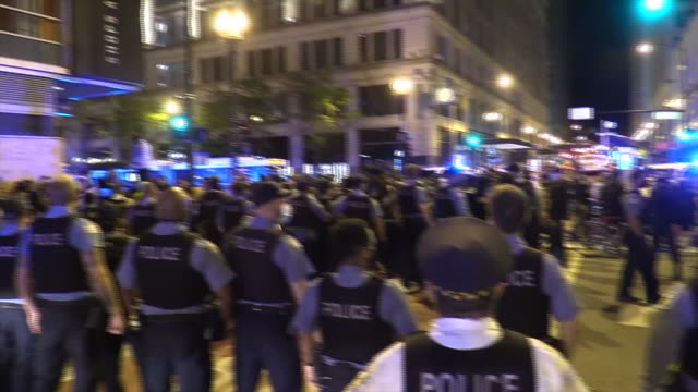 wgn chicago il us cordon of police during chicago protest hundreds of protesters marched through chicago after the death of george floyd in... - i can't breathe stock videos & royalty-free footage