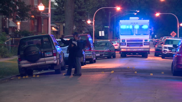 chicago, il, u.s. - crime scene by night after 5 shot, 2 killed in west englewood, as a part of violent labor day weekend in which chicago police... - shooting crime stock videos & royalty-free footage