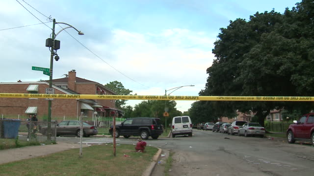 chicago, il, u.s. - crime scene surrounded by cordon tape, on sunday, august 4, 2019. - western script stock videos & royalty-free footage