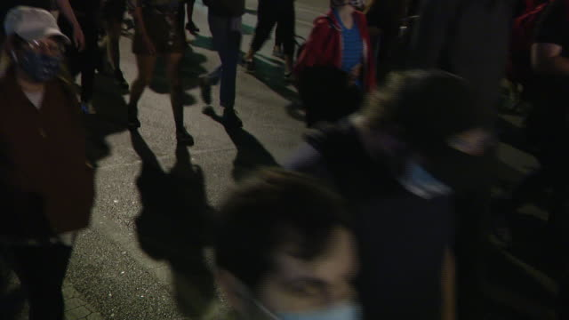 chicago, il, u.s. - crowds marching at rally demanding justice for breonna taylor on friday, september 18, 2020. - orthographic symbol stock videos & royalty-free footage