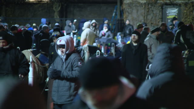 chicago, il, u.s. - crowds waiting at night outside store for annual black friday release of goose island's limited edition bourbon county stout at... - black friday stock videos & royalty-free footage