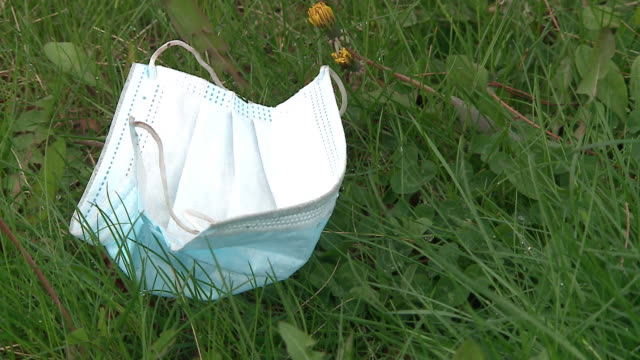 chicago, il, u.s. - discarded face masks on lawn and street in chicago's north center neighborhood mostly outside post office near kedzie & grace.... - rubbish stock videos & royalty-free footage