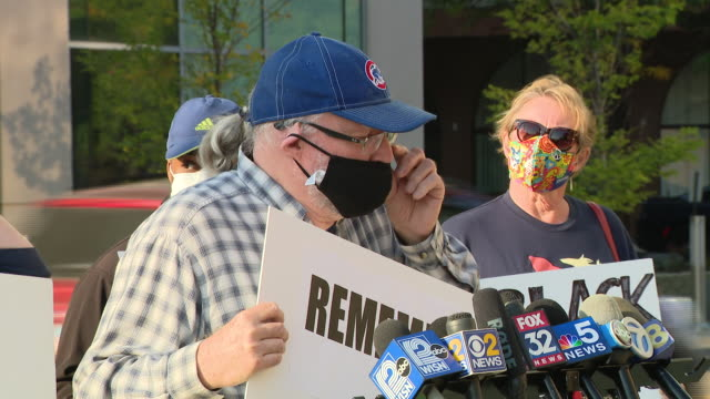 chicago, il, u.s. - donald blake holds a placard and addresses supporters and the media gathered outside courthouse during kyle rittenhouse's... - shot put stock videos & royalty-free footage