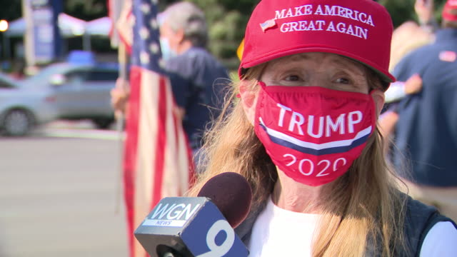 chicago, il, u.s. - donald trump supporters in front of walter reed national military medical center speaking about president and pandemic on sunday,... - ベセスダ点の映像素材/bロール