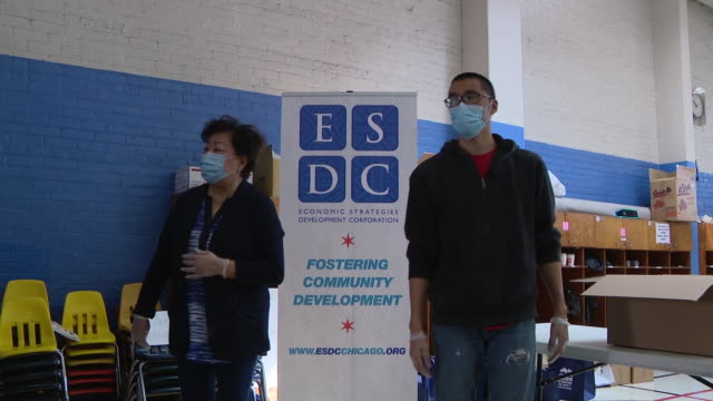 chicago, il, u.s. - esdc employees and close-up of information sign. esdc hosts emergency food distribution event at chinese christian union church... - information sign stock videos & royalty-free footage