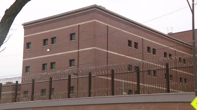 wgn chicago il us exterior of cook county jail with help signs on windows during covid19 pandemic in chicago on saturday april 11 2020 - prison window stock videos & royalty-free footage