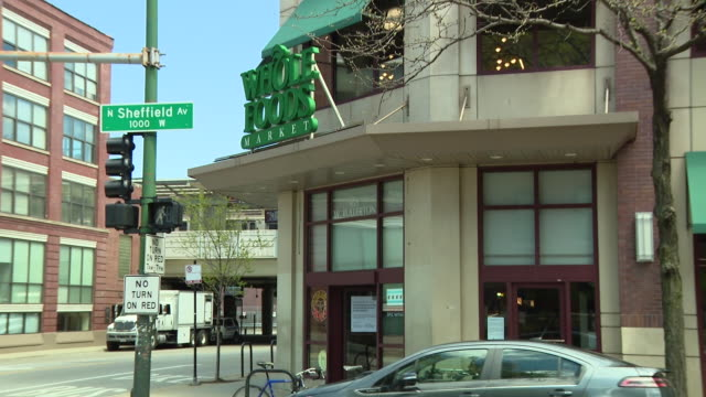 wgn chicago il us exterior of whole foods store at sheffield fullerton in chicago's lincoln park neighborhood store is closing to transition to... - chicago illinois stock videos & royalty-free footage