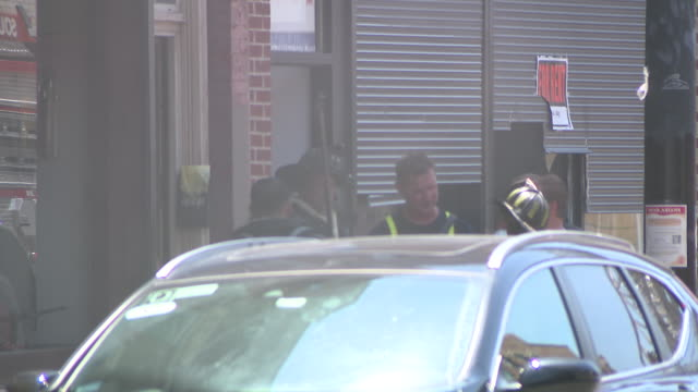 wgn – chicago il us fire fighters in street helping community members after a fire in chinatown on tuesday july 14 2020 - non western script stock videos & royalty-free footage