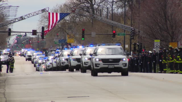 wgn chicago il us firefighters standing along street during funeral procession of first chicago firefighter who died of complications from covid19... - people standing in a row stock videos & royalty-free footage