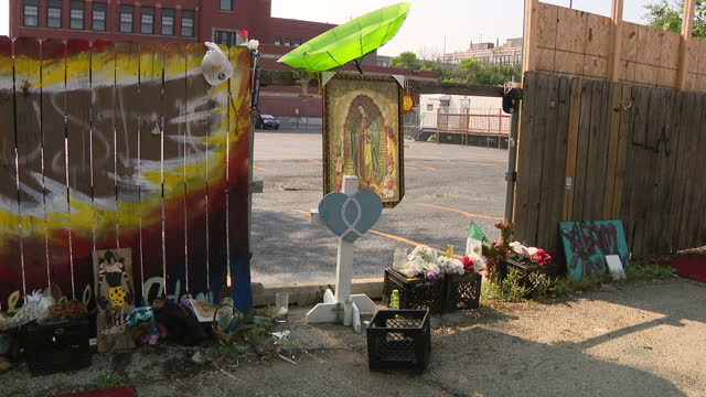 chicago, il, u.s. - flowers and placards in alleyway where adam toledo was fatally shot by the police, on thursday, july 29, 2021. community groups... - male likeness stock videos & royalty-free footage
