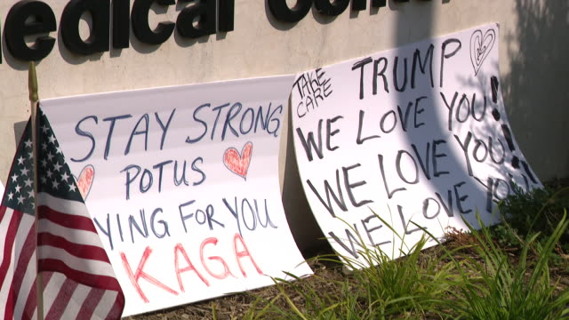 chicago, il, u.s. - flowers, toys and messages for donald trump left by supporters near walter reed national military medical center on sunday,... - ベセスダ点の映像素材/bロール