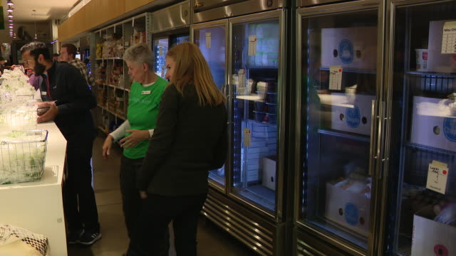 chicago, il, u.s. - food pantry for beneficiaries of supplemental nutrition assistance program which is about to change under new trump's food stamp... - beneficiary stock videos & royalty-free footage