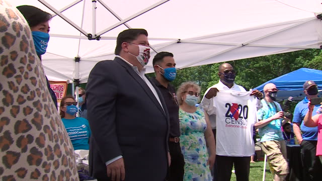 chicago, il, u.s. - governor pritzker giving autographs at census event on friday, july 17, 2020. - orthographic symbol stock videos & royalty-free footage