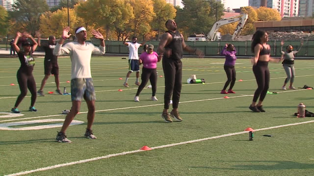 wgn chicago il us group of people doing jumping jacks during voter registration event named sweat and vote attendees got a free outdoor working out... - verification stock videos & royalty-free footage