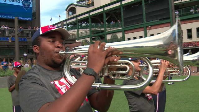 wgn chicago il us howard university band and cheerleaders perform at gallagher way at wrigley field as part of the chicago cubs' hbcu day on friday... - チアリーダー点の映像素材/bロール