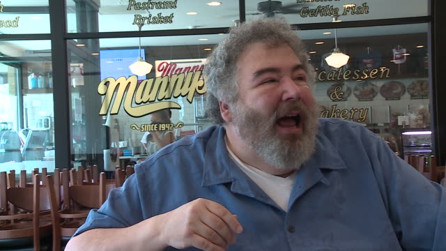 chicago, il, u.s. - long time customer speaking about new setup and old faces at deli. manny's deli, a popular gathering place before the covid-19... - mature adult stock videos & royalty-free footage