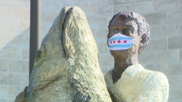 chicago, il, u.s. - masked bronze statue of man with fish at shedd aquarium as it reopens after closing due to covid-19 on friday, july 3, 2020. - shedd aquarium stock videos & royalty-free footage