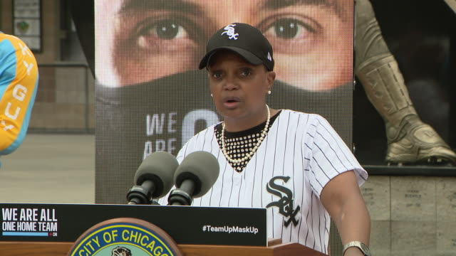 chicago, il. u.s. - mayor lori lightfoot wearing white sox cap and jersey at press conference. mayor lori lightfoot joined chicago's sports teams to... - baseball strip stock videos & royalty-free footage