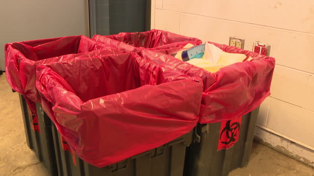 chicago, il, u.s. -medical sharps waste containers at rush university medical center prepared for covid-19 patients on wednesday, march 11, 2020. - toxic waste stock videos & royalty-free footage