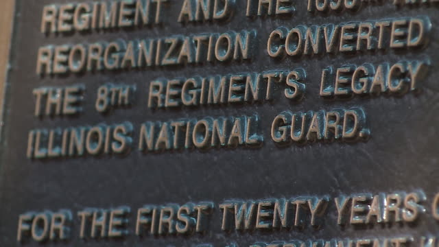 chicago, il, u.s. - memorial plaque on chicago military academy bronzeville building wall on tuesday, august 25, 2020. - wall building feature stock videos & royalty-free footage