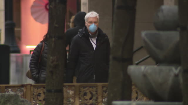 chicago, il, u.s. - nearly empty streets with few pedestrians wearing protective masks during covid-19 pandemic, on thursday, march 25, 2020. - pedestrian stock videos & royalty-free footage
