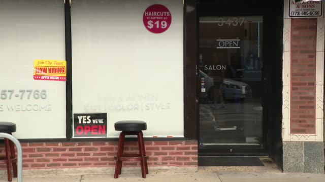 chicago, il, u.s. - open sign on hair salon window in chicago's wrigleyville neighborhood on monday, july 20, 2020. businesses in chicago's... - stool stock videos & royalty-free footage