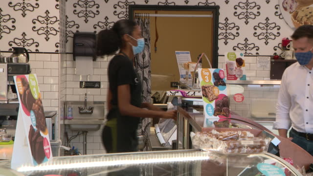 chicago, il, u.s. - owner at kilwins ice cream store on sunday, august 2020. a second round of looting in downtown chicago largely targeted some... - entrepreneur stock videos & royalty-free footage