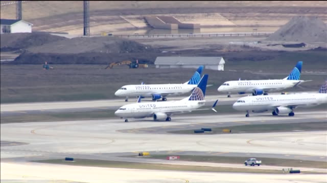 chicago, il, u.s. - parked airplanes at chicago's o'hare airport as it closes two runways as air travel plummets over covid-19 on wednesday, april 1,... - stationary stock videos & royalty-free footage