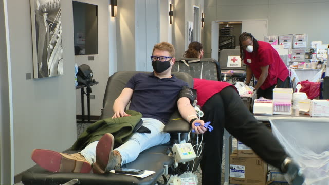 chicago, il. u.s. - people at the american red cross blood drive next to chicago's wrigley field on friday, april 24, 20.20. 100 people donated... - blood donation stock videos & royalty-free footage