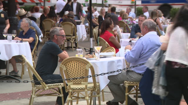 chicago, il, u.s. - people dining on restaurant's patio in gold coast neighbourhood on tuesday, august 25, 2020. - outdoors stock videos & royalty-free footage
