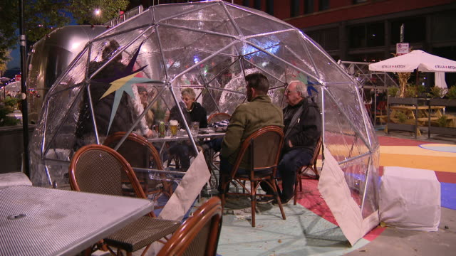 chicago, il, u.s. - people dining outdoors in plastic igloo as chicago restaurants are preparing for colder weather amid coronavirus pandemic, on... - transparent stock videos & royalty-free footage