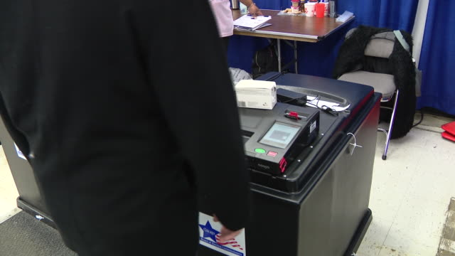 chicago, il, u.s. - people early voting in the 2020 illinois primary elections the day before election day and in the wake of covid-19 at chicago's... - ballot slip stock videos & royalty-free footage