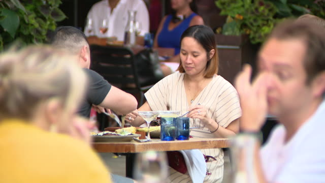 chicago, il, u.s. - people eating out in the middle of chicago's clark street, which was closed to traffic between grand and kinzie, as part of... - pedestrian zone stock videos & royalty-free footage
