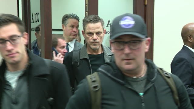 chicago, il, u.s. - people entering lottery room to pick store locations for recreational marijuana in chicago, on friday, november 15, 2019. - rathaus stock-videos und b-roll-filmmaterial