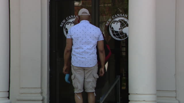 chicago, il, u.s. - people entering new canaan land missionary baptist church on chicago's south side on sunday, may 24, 2020. - baptist stock videos & royalty-free footage