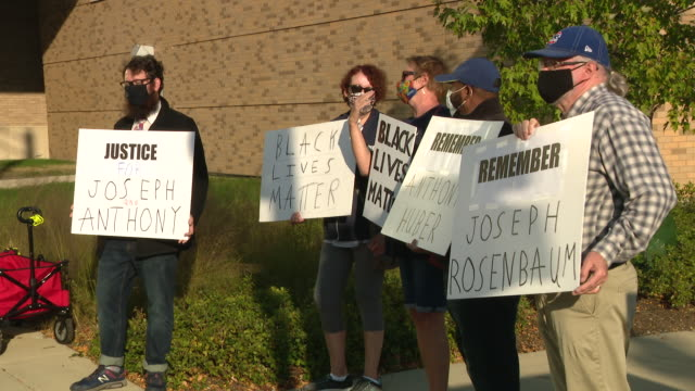 chicago, il, u.s. - people hold signs outside the lake county courthouse in waukegan to remember the two men fatally shot during protests in kenosha... - shot put stock videos & royalty-free footage