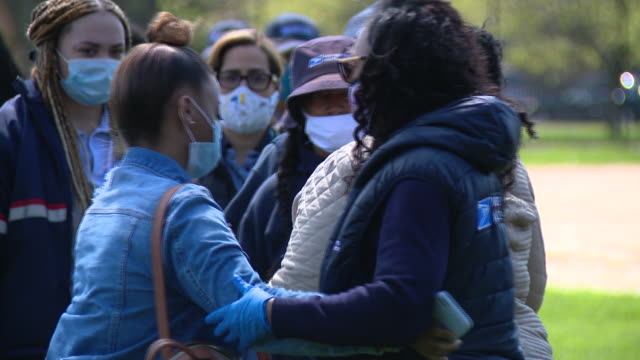 wgn chicago il us people hugging each other after balloon release at kilbourn park after unique clay was the first chicago usps postal service letter... - postal worker stock videos & royalty-free footage
