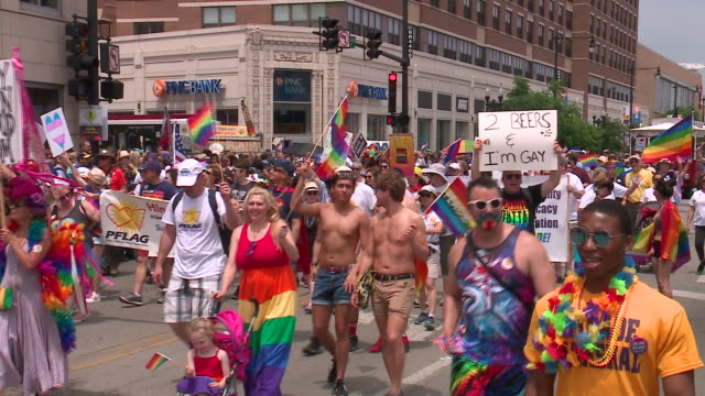 wgn chicago il us people in colorful costumes and parade float at pride parade in boystown neighborhood on sunday june 30 2019 - festwagen stock-videos und b-roll-filmmaterial