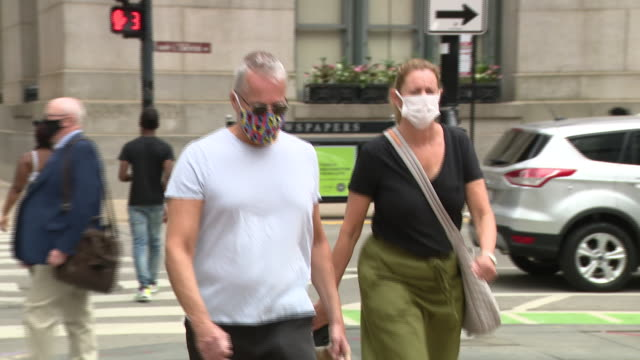 chicago, il, u.s. - people in face masks. joann cunningham was sentenced to 35 years in the murder of her son. after first reporting aj missing in... - autopsy stock videos & royalty-free footage