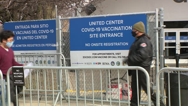 chicago, il, u.s. - people in face masks stand in a line o enter the united center mass vaccination site on tuesday, march 9, 2021. the united... - chicago illinois stock videos & royalty-free footage