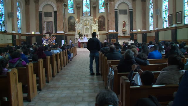 chicago, il, u.s. - people in st. agnes of bohemia church during dia de los muertos celebrations, the mexican holiday knows as the day of the dead on... - altar stock videos & royalty-free footage