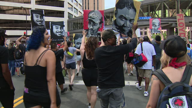 chicago, il, u.s. - people marching after derek chauvin sentencing in minneapolis, mn, on friday, june 25, 2021. former minneapolis police officer... - male likeness stock videos & royalty-free footage