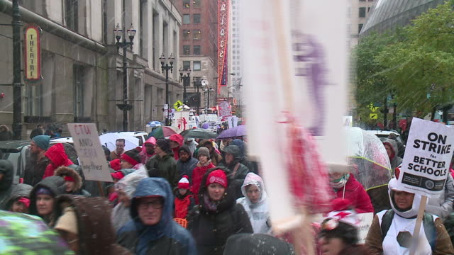 chicago, il, u.s. - people marching in snow during last day of chicago teachers strike, on thursday, october 31, 2019. union teachers and school... - new hire stock videos & royalty-free footage