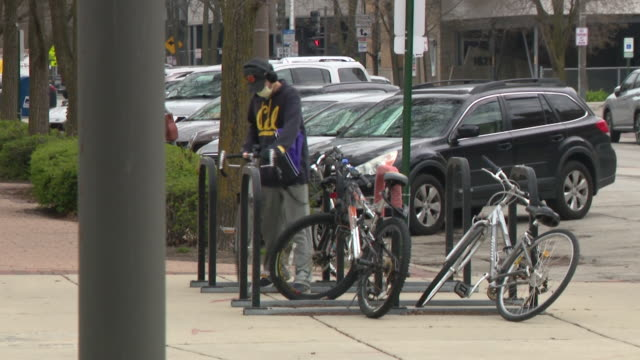 wgn chicago il us people on streets of evanston which issued an order requiring a mask for anyone shopping or working on thursday april 23 2020 - bus driver stock videos & royalty-free footage