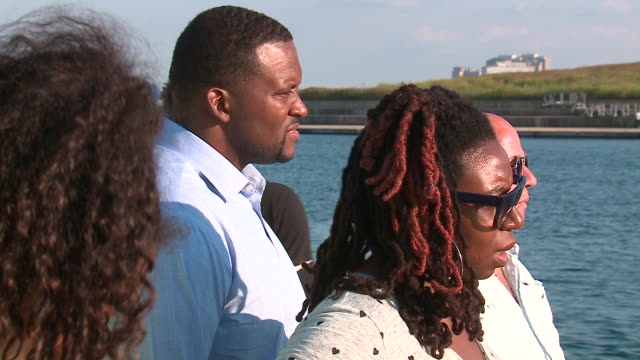 wgn chicago il us people watching chicago bears legend charles 'peanut' tillman complete lake michigan row fundraiser on monday sep 2 2019 - great lakes stock videos & royalty-free footage