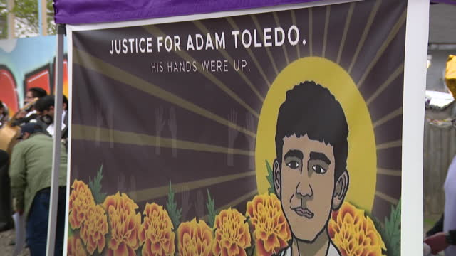 chicago, il, u.s. - placards and banners at community vigil for 13-year old adam toledo, shot and killed by police, in little village on sunday,... - male likeness stock videos & royalty-free footage